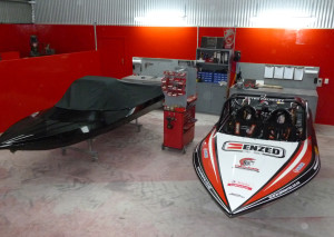 Caughey's championship-winning boat (right) beside a client boat in the new workshop